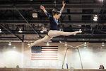 Women gymnasts compete in tri-meet