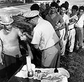 This 1965 photograph shows a group of Cuban men be