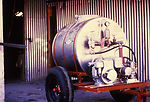 This 1981 photograph depicts an orchard sprayer, u