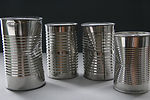 Depicted here, are four unlabeled metal cans conta