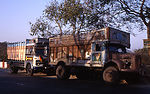 This 2000 photograph depicted two large trucks, th