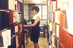 This 1970 photograph depicts librarian, Evelyne Co