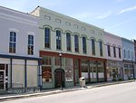This is 114-116 East Main Street (the green building) in Princeton, KY. It is on the National Register of Historic Places. Category:Images of Caldwell County