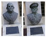 Photograph of the busts of Carlton de Castro and Isaac Fonseca outside of the Legislative Council building in Road Town, Tortola, British Virgin Islands