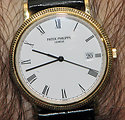 A circa 1999 men's quartz Calatrava, a dress watch built by the premier Swiss watchmaker Patek Philippe. It is in yellow gold, with a second hand and date