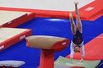 Français�:  Youna Dufournet prend sa première impulsion sur les mains au sol, en qualifications du saut de cheval, aux 17e Internationaux de France (2010).