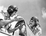 6 June 1941. Lydda, British Mandate of Palestine. Squadron Leader Peter Jeffrey of No. 3 Squadron who was recently awarded the D.F.C. goes over the points of the new American 'Tomahawk' with P/O Peter Turnbull one of the original and leading RAAF pilots