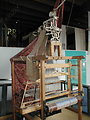 Jacquard loom on display at the Manchester museum of science and industry. Photograph taken by George H. Williams in July, 2004.