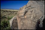 A Petroglyph (Rock Art) is shown with the blue Arizona sky hanging over the 71,000 acre Agua Fria National Monument in the Background.