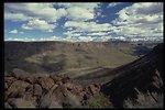 The Agua Fria Canyon below a cloud peppered Arizona sky.