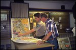 Ed Perault, helps customers locate the best fishing holes in Arizona. The Arizona Public Lands Information Center (PLIC) is a partnership between the nonprofit Public Lands Interpretive Association and the Bureau of Land Management. The Center offers one-