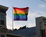 Six color rainbow gay pride flag flying above Castro Street, San Francisco, California, June 2005. Photo by Justin J.W. Powell.