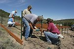 Volunteers help BLM build guzzlers to provide water for wildlife.