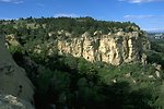 Sun shining on the sandstone cliffs in the Four Dances Natural Area