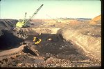 Draglines, trucks and shovels are used to mine coal from multi-seam deposit near Centralia, Washington.