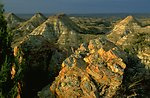 Sun shining on the cliffs in the Terry Badlands - unusual colors