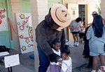 Smokey Bear helping kids learn about fire prevention at a Head Start Fair.