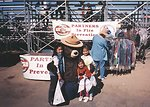 Smokey Bear with children at the rodeo