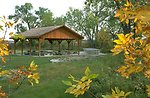 Group Picnic Shelter framed with autumn leaves