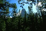 Rock formation towering over the trees