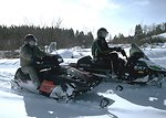Snowmobiling on a mountain site.