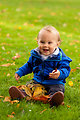 Baby playing in fall