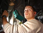 Airman makes sure cargo dome lights in a C-130 Hercules work