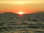 Sunset between Santa Cruz and Anacapa Islands as viewed from the contract fishery research vessel AGRESSOR.