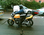 Motorcycle courier, London 2007. (Taken with Nokia 6230i by Battersea Bridge).