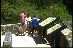 Family reads interpretive panels at the Swiftwater Recreation Site.