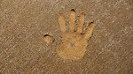 Hand print in the sand