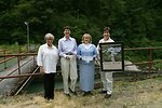 Kathleen Clarke (left), BLM Director, and Elaine Brong (right), BLM Oregon State Director, present the Four C's Award at the Little Sandy Dam to the Western River Conservancy Vice President, Sue Doroff (second from left), and  President of Administration