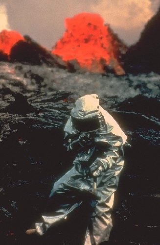 Scientist studying volcano.
