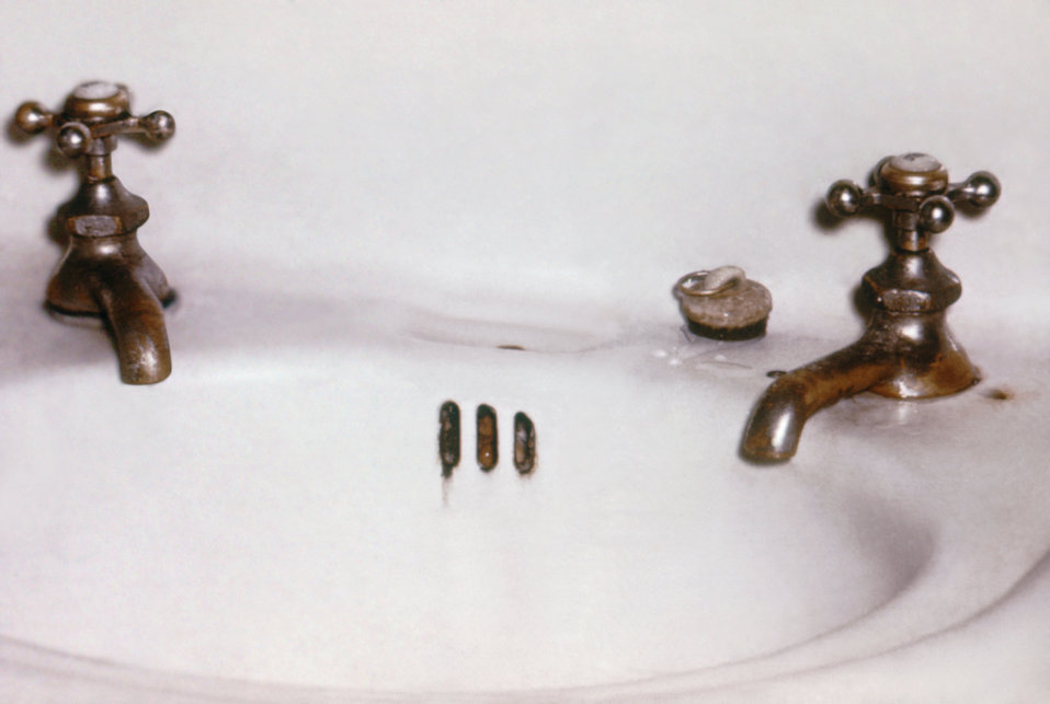 This image shows lavatory faucet openings located below the water spill rim, which makes back-siphonage of dirty water possible.