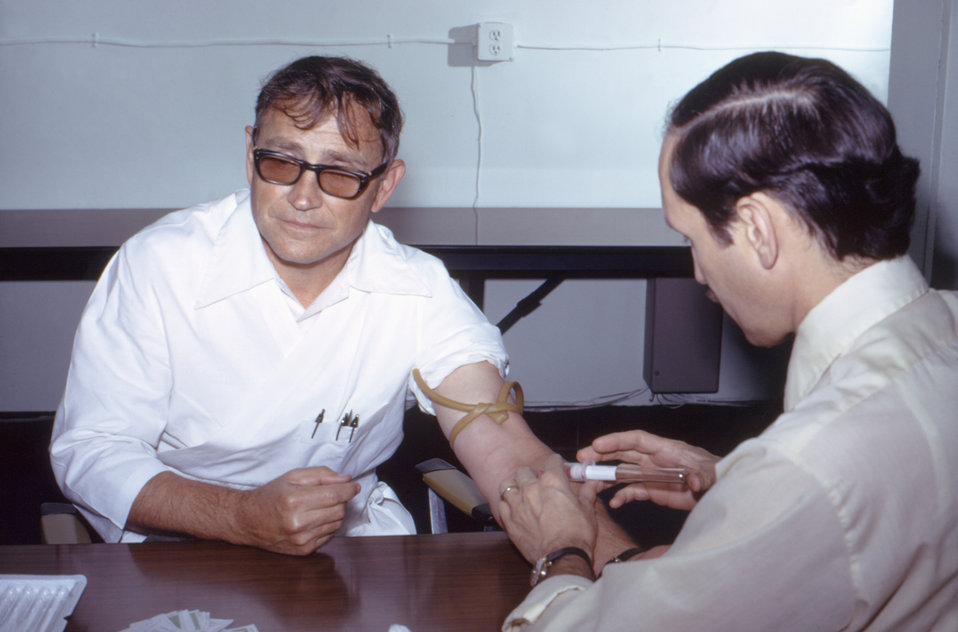 In this 1976 photograph, Dr. Gary Noble was drawing blood to be tested for its antibody concentrations.