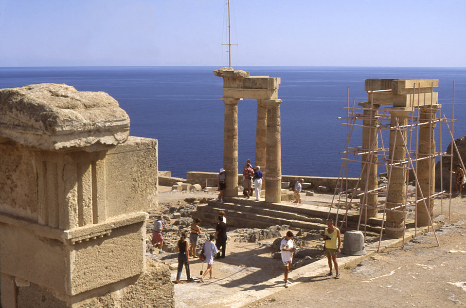 This 1993 photograph depicted a number of tourists sight-seeing amongst the ruins of the ancient Acropolis, outside the Greek city of Lindo,