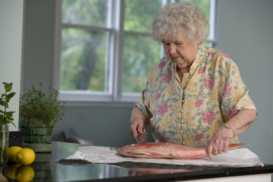 Here, an elderly woman was in the process of preparing a fresh fish on her clean kitchen counter.  Having scaled and gutted the fish, while