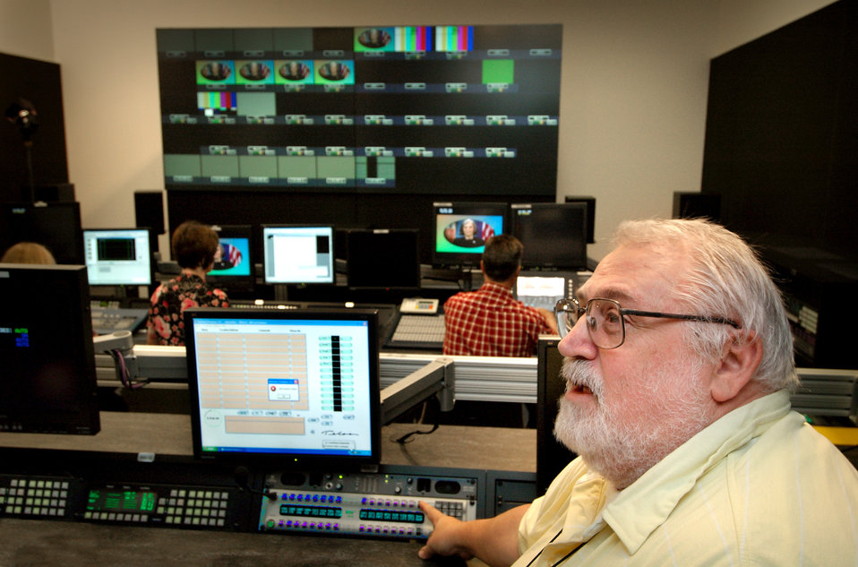 This photograph shows Centers for Disease Control's television broadcast Editor/Director, Ron Bartlett, as he was working in one of the broa
