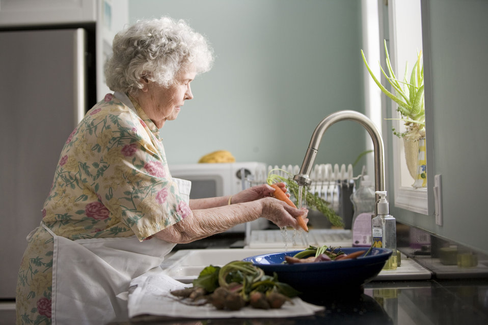 Properly cleaning fresh, uncooked produce is a must when preparing a meal, and with this in mind, the elderly woman pictured here was doing