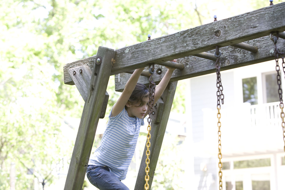 A young girl on a swing set