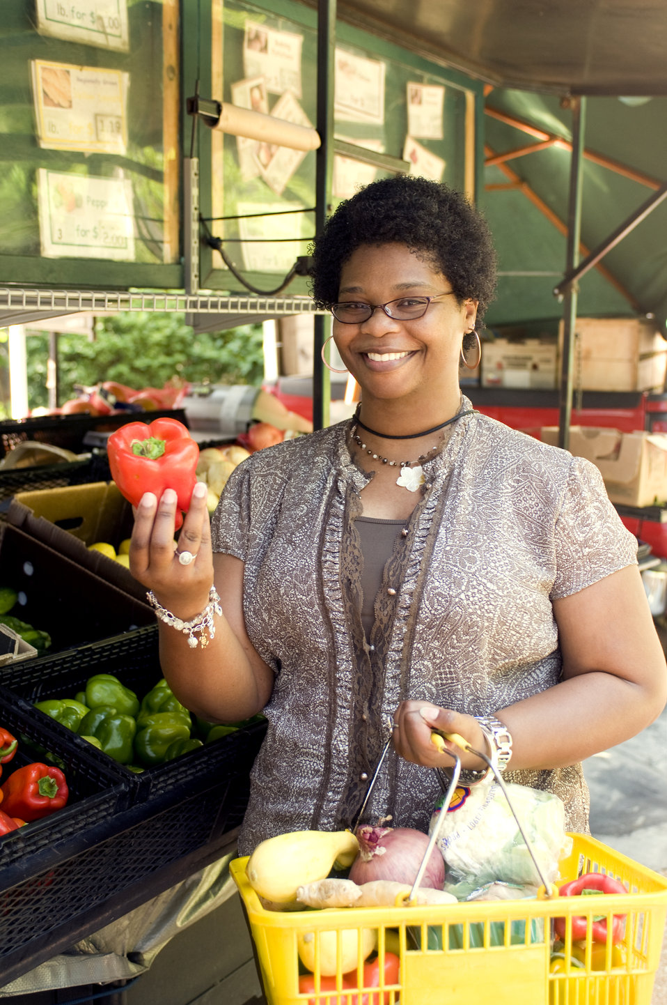 With her shopping basket filled with an array of healthy food choices, this woman had completed her selection process at a mobile produce ma