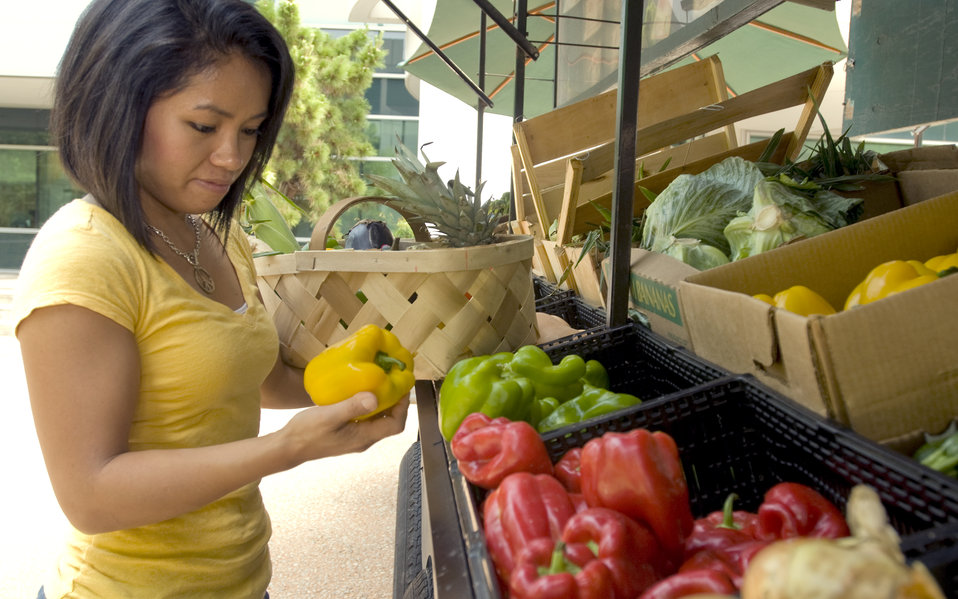 A woman shopping for produce