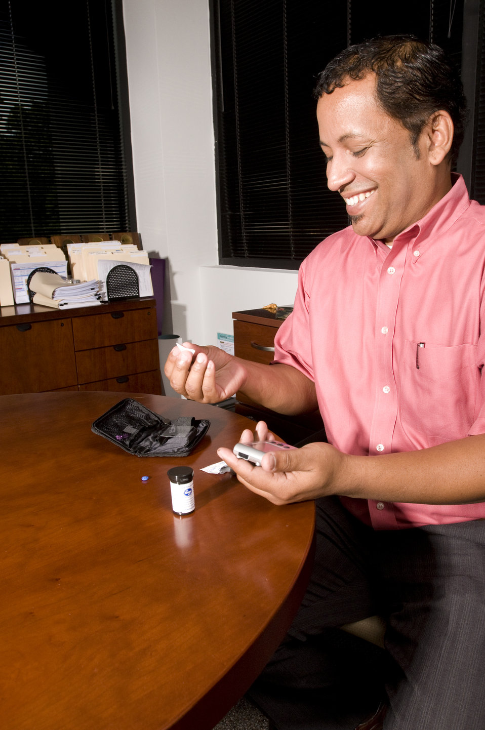 The man pictured here was checking his blood glucose level. This process is known as self-monitoring blood glucose, and it's a way for peopl