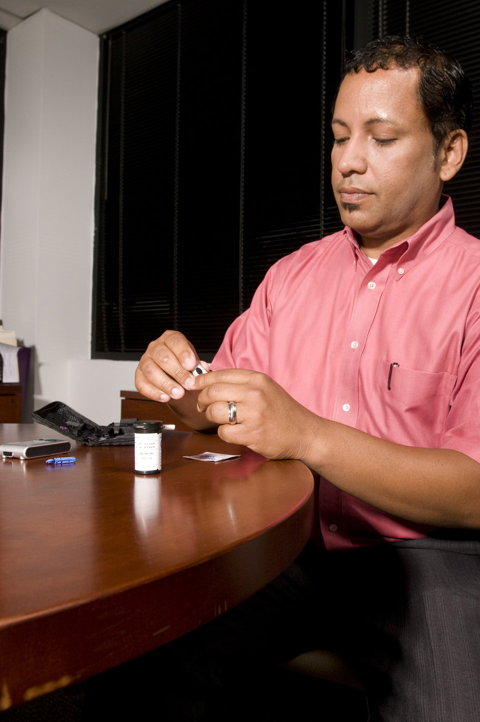 The man pictured here, was about to check his blood glucose level. This process is known as self-monitoring blood glucose, and it's a way fo