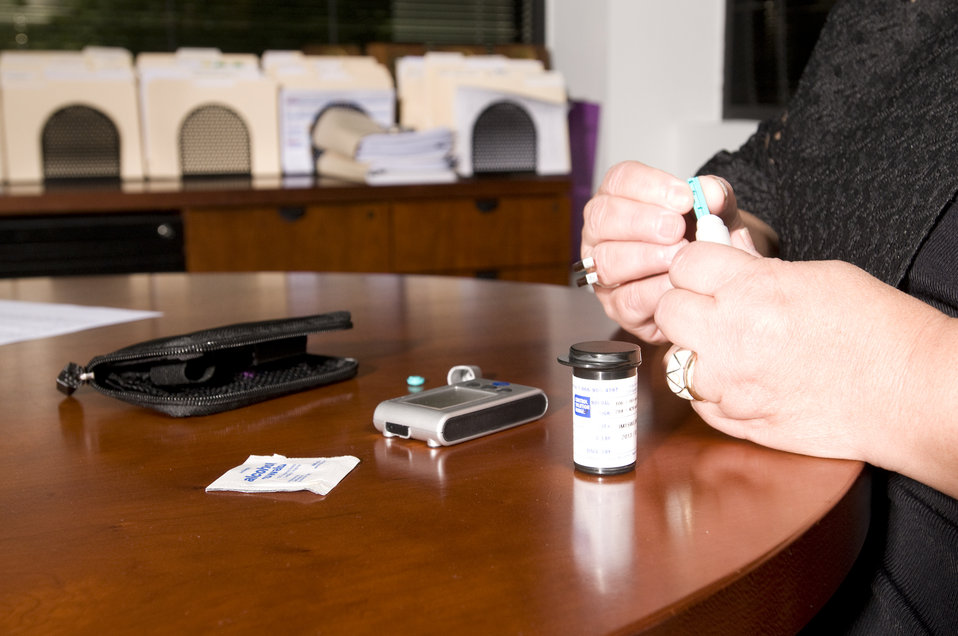 The woman pictured here, was about to check her blood glucose level. This process is known as self-monitoring blood glucose, and it's a way