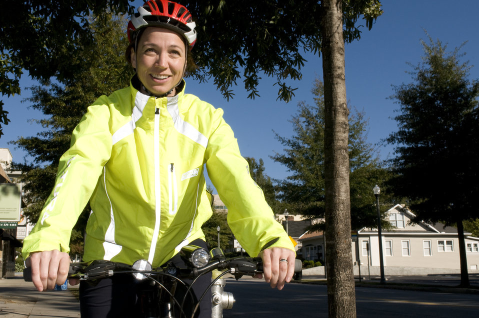 Photographed on a sunny Georgia day was this smiling female bicyclist, who was embarking on a bicycle ride. Note the brightly-colored windbr