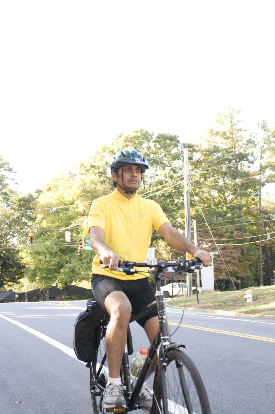 Photographed on a sunny Georgia day was a male bicyclist who had embarked on a morning bicycle ride. Note the brightly-colored shirt he was