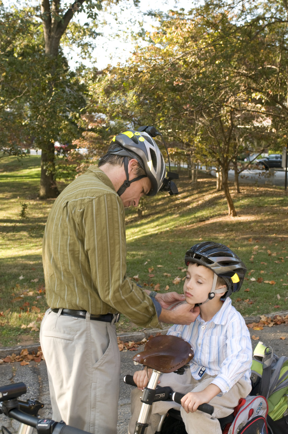 This photograph depicts a father and son about to embark on a beautiful Georgian afternoon bicycle ride. At this point in their preparation,
