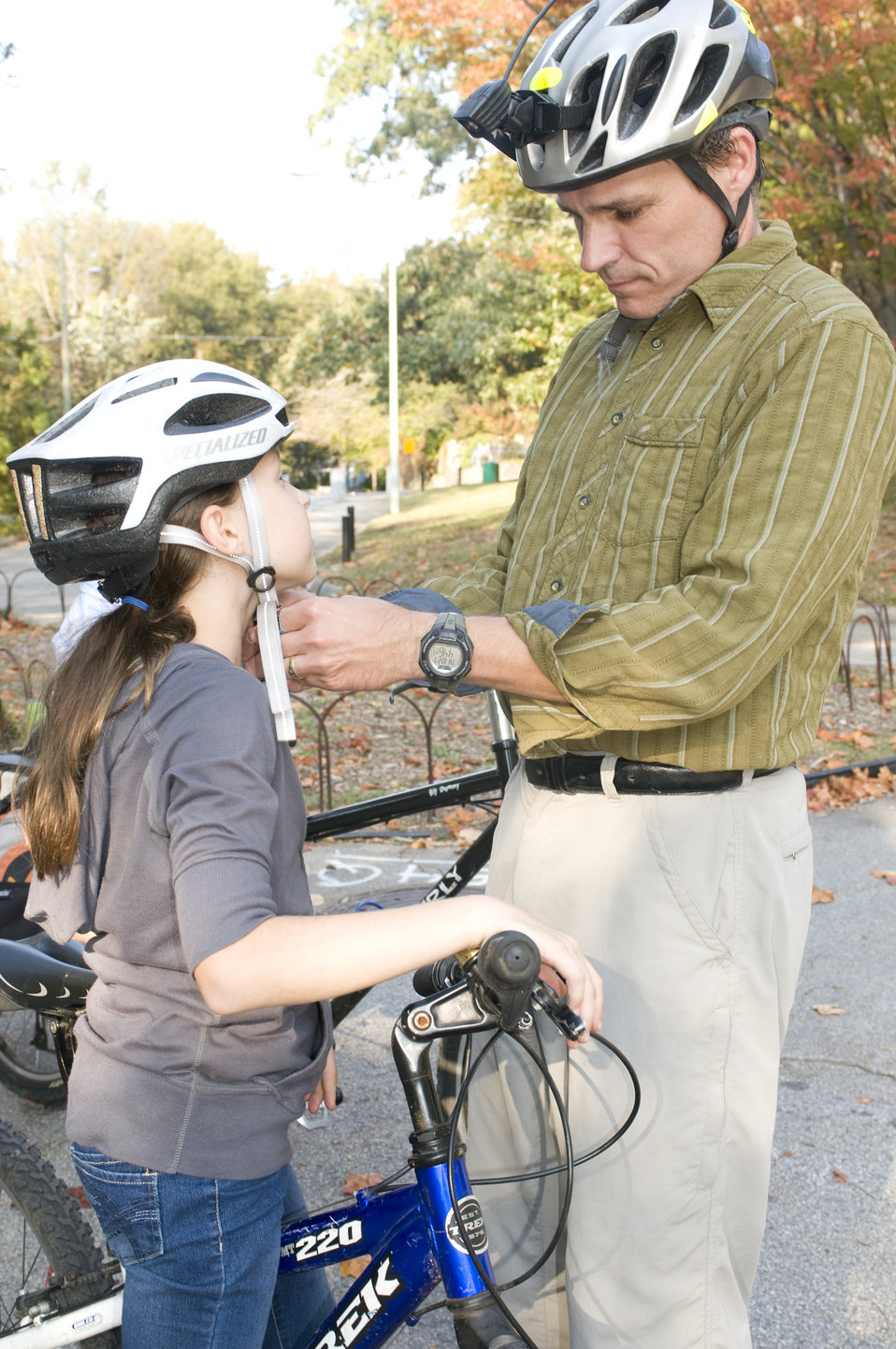 This photograph depicts a father and daughter about to embark on a beautiful Georgian afternoon bicycle ride. At this point in their prepara