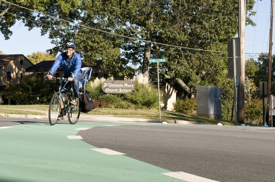 This photograph depicts a male bicyclist, who was riding his bicycle on a sunny Georgia morning. Note the brightly-colored windbreaker he wa